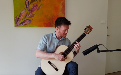 Matt Withers plays a Toscano Classical Guitar